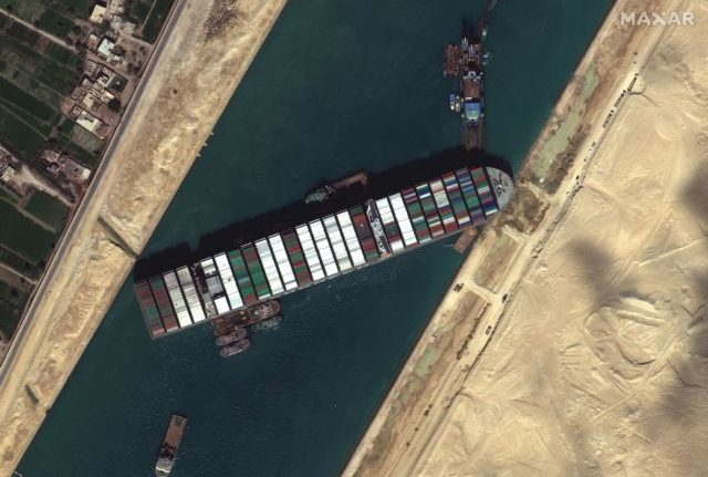 Ever Given container ship is pictured in Suez Canal, in Suez Canal in this Maxar Technologies satellite image taken on March 27, 2021. Satellite image ©2021 Maxar Technologies/Handout via REUTERS ATTENTION EDITORS - THIS IMAGE HAS BEEN SUPPLIED BY A THIRD PARTY. MANDATORY CREDIT. NO RESALES. NO ARCHIVES. DO NOT OBSCURE LOGO.